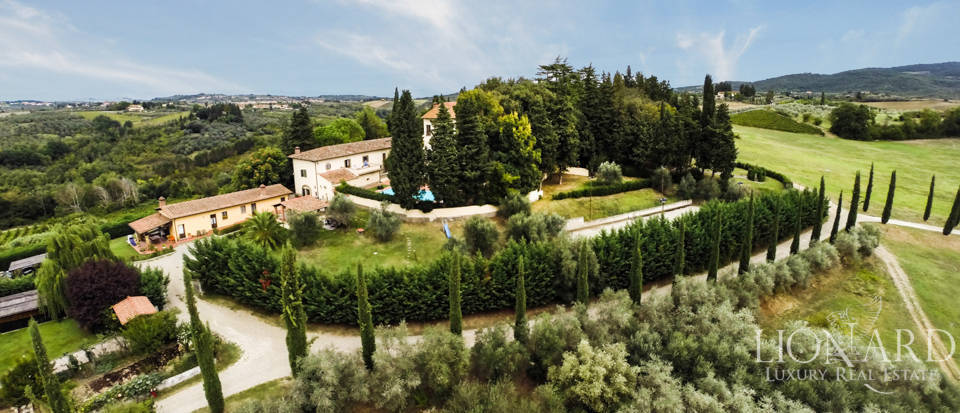 luxury villa with pool and vineyard in the hills of florence