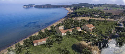 refined property framed by the bay of baratti