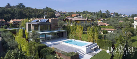 modern villa with lake view overlooking garda