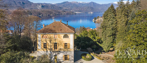 historical luxury villa in front of lake orta