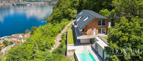 new luxury villa with view of lake lugano