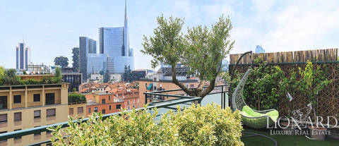 modern penthouse with panoramic terrace in the heart of milan
